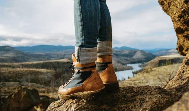 A woman wearing a pair of -hiking-boots