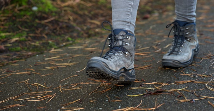 a hiker walking in their boots in an urban environment