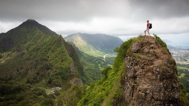 Man on top of the mountains watching the landscape