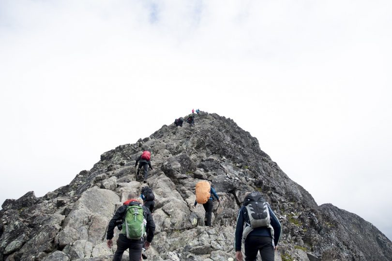 backpakers climbing a mountain