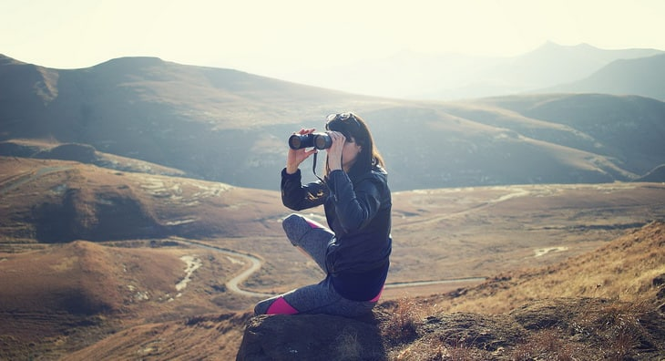woman watching the landscape with a binocular