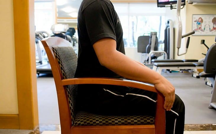 man showing a chair exercise