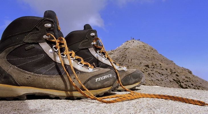 Image showing a pair of hiking boots in from of a pyramid