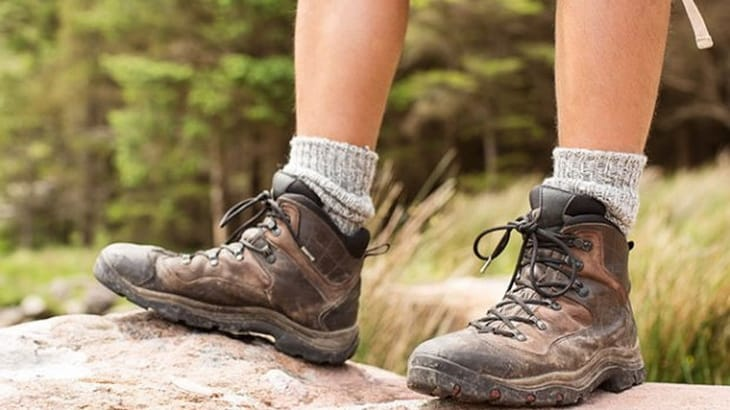 A man wearing regular hiking boots