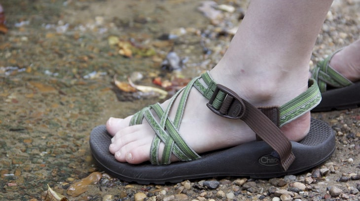 Image of a woman wearing a pair of hiking sandals in the summer