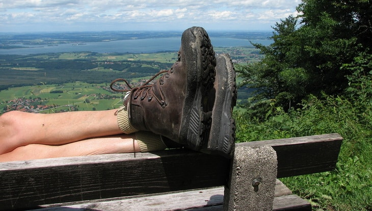 Image showing a person's legs while is wearing a pair of hiking boots