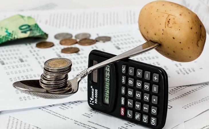 balancing some coins and a potato