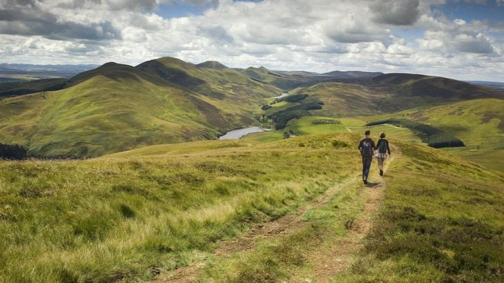 couple-walking-downhill