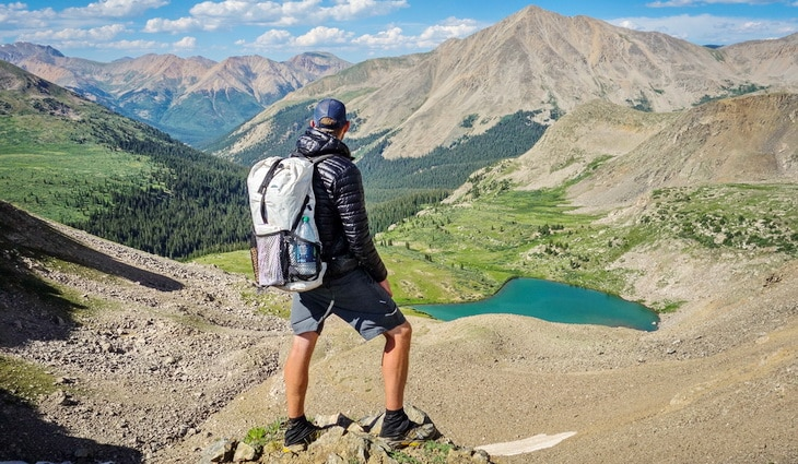 Man with a DIY backpack watching the landscape