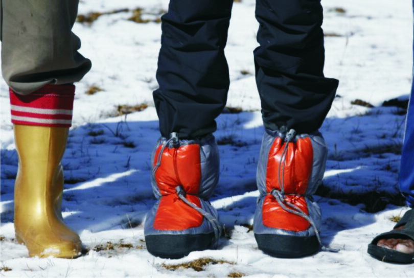 hikers wearing down booties