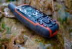 Image of a gps-garmin-64 GPS on the ground