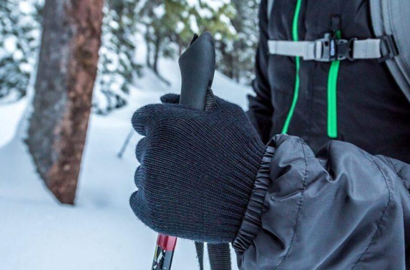 hiker wearing merino wool gloves