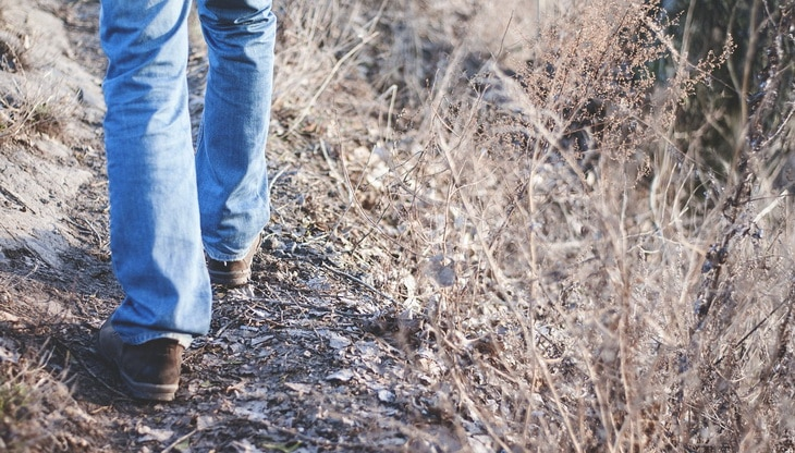 Man hiking 10 miles in jeans