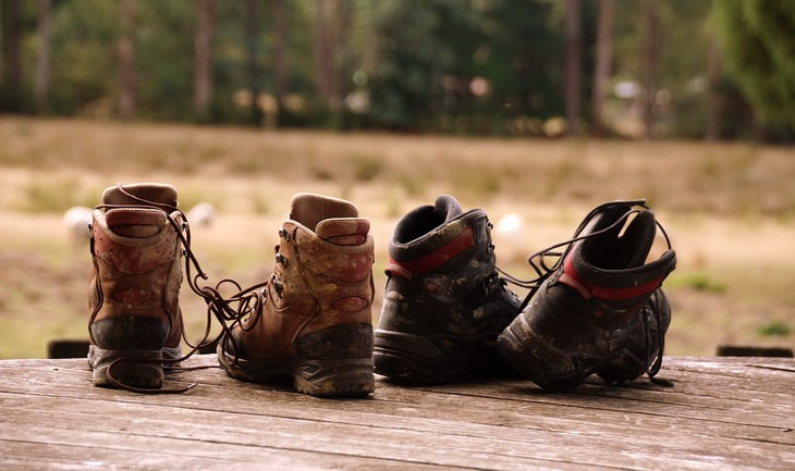 hiking boots on the ground outside