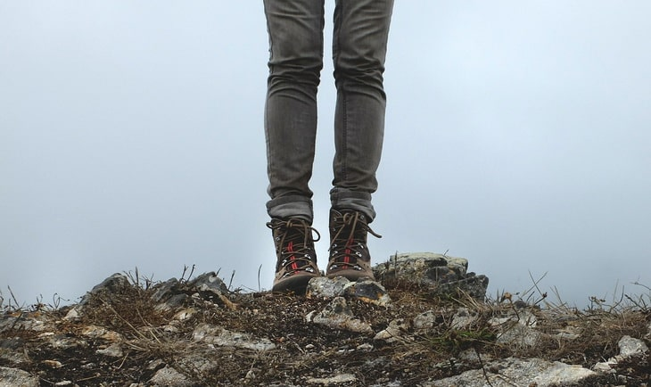 A woman hiking in skinny jeans