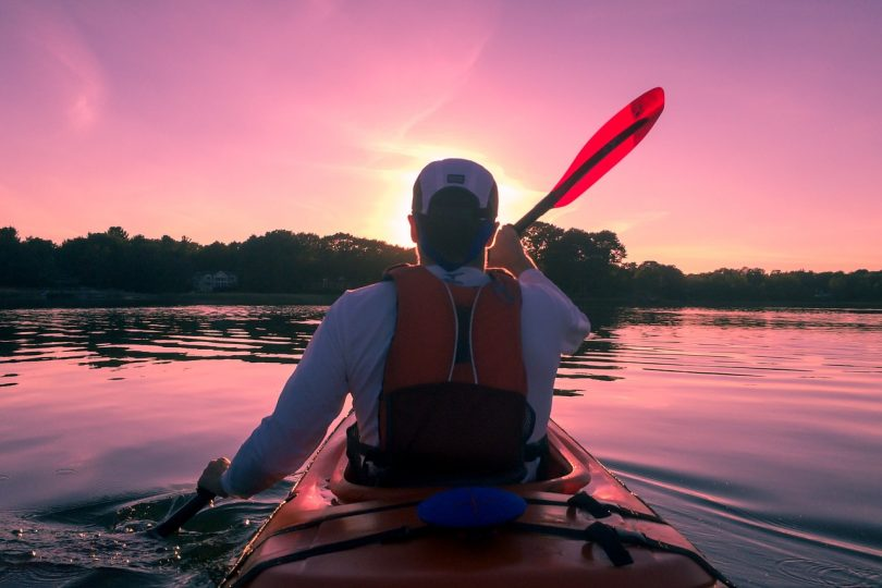 picture of a person kayaking during daylight