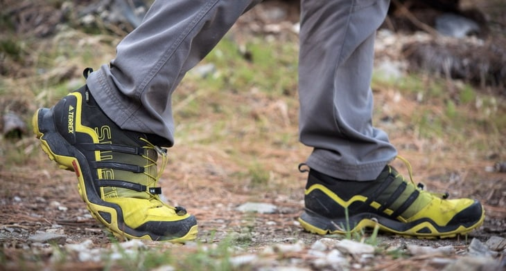 A man hiking in lightweight Terrex Swift