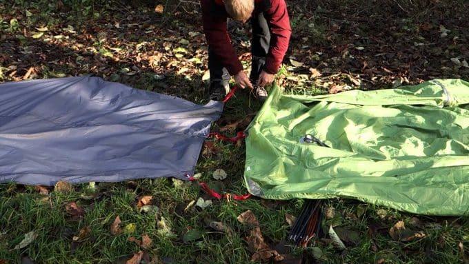 man-put-tent-and-footprint