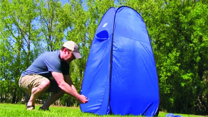 man with privacy shelter