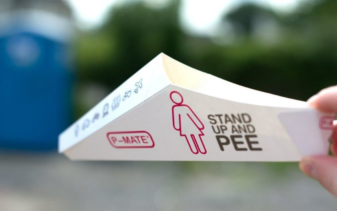 Image showing a person holding a paper Image showing a woman holding a Female-Urination-Device