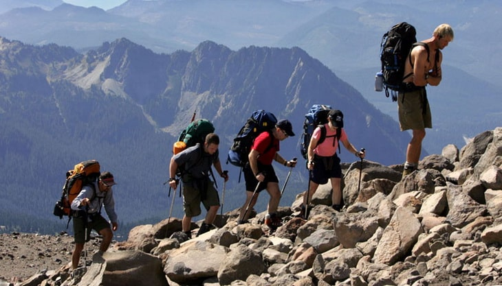 backpackers climbing the mountain