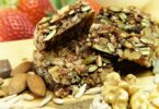 close-up picture of nut bars and dried figs