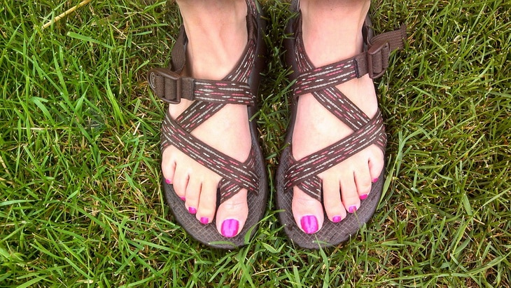 A woman s legs wearing a pair of hiking sandals