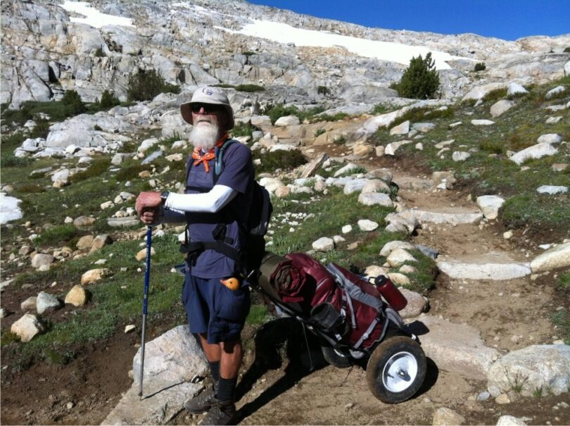 old-man-with-backpacking-cart
