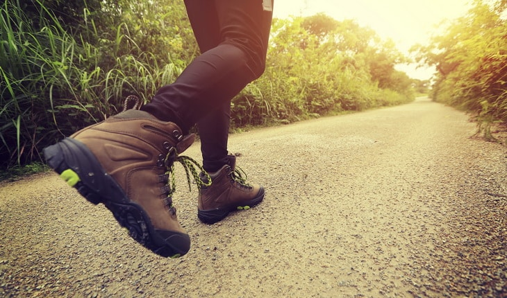 woman hiking on forest trail