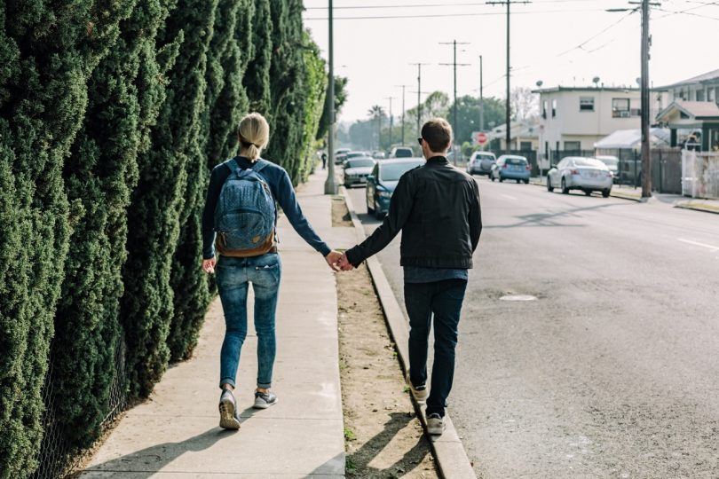 couple walking together on a road