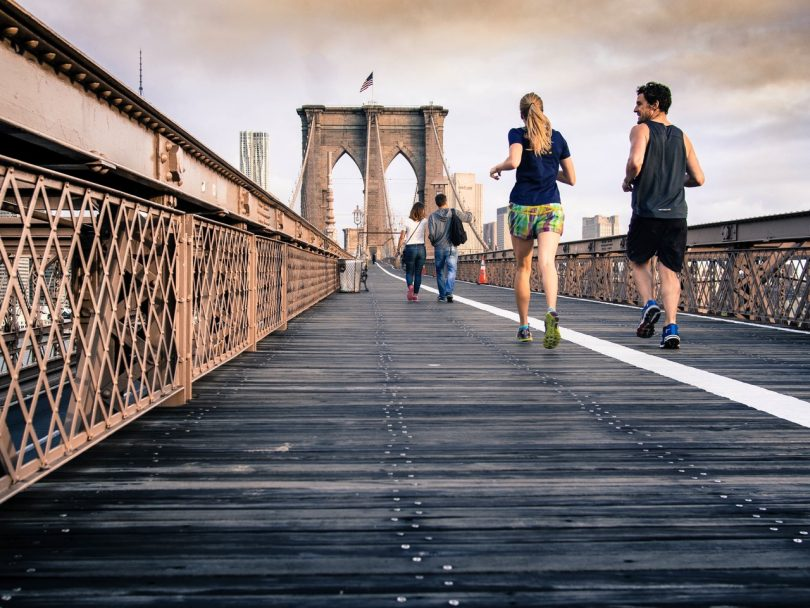 picture of two runners on a bridge
