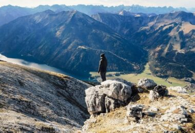 Man Standing on Top of the Mountain