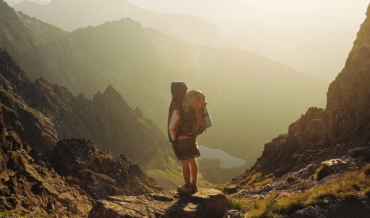 backpacker on the top of the mountains