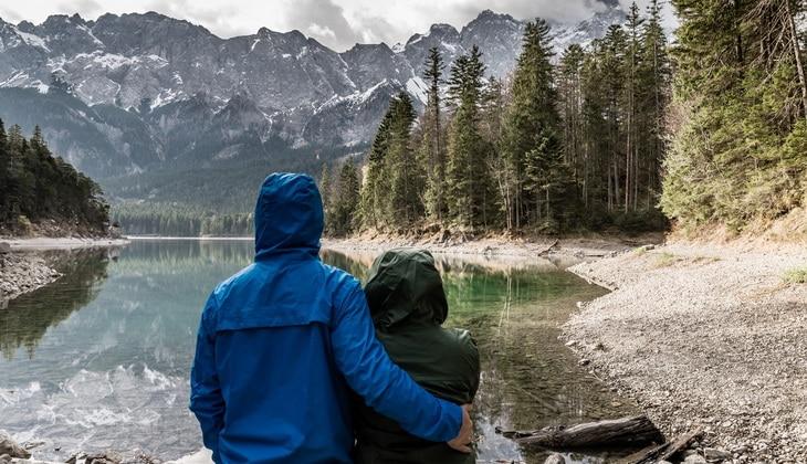 couple watching a beautiful mountain landscape