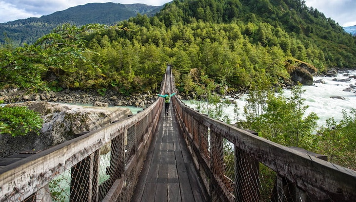 hiker passing queulat bridge