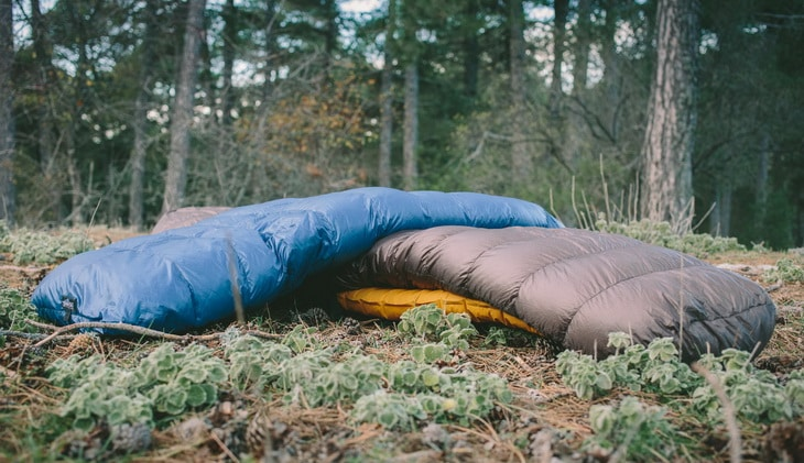 quilt-and-a-sleeping-bag on the grass