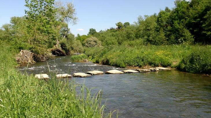 crossing rocks on a river