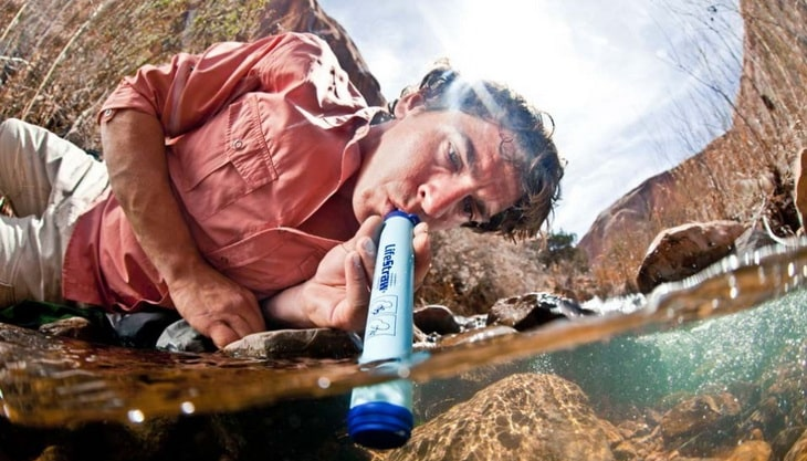 A man using a water filter