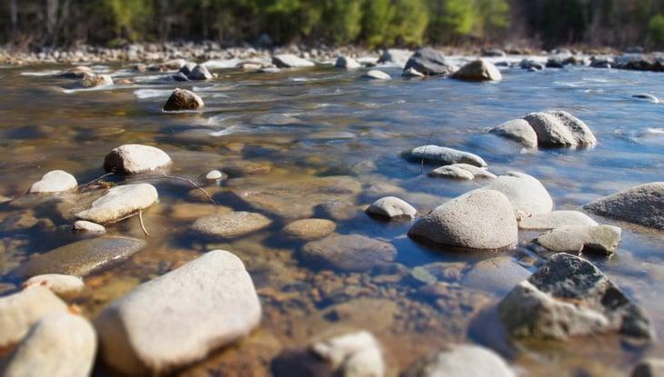 summer-rocks-near a river