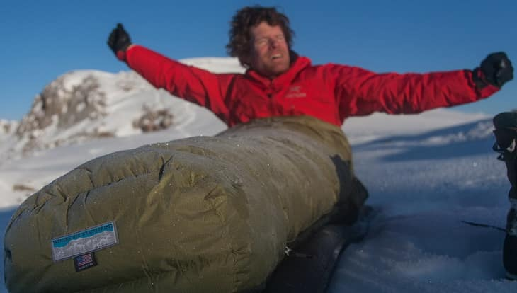 Man getting up in a Western Mountaineering Puma Gore WS Sleeping Bag