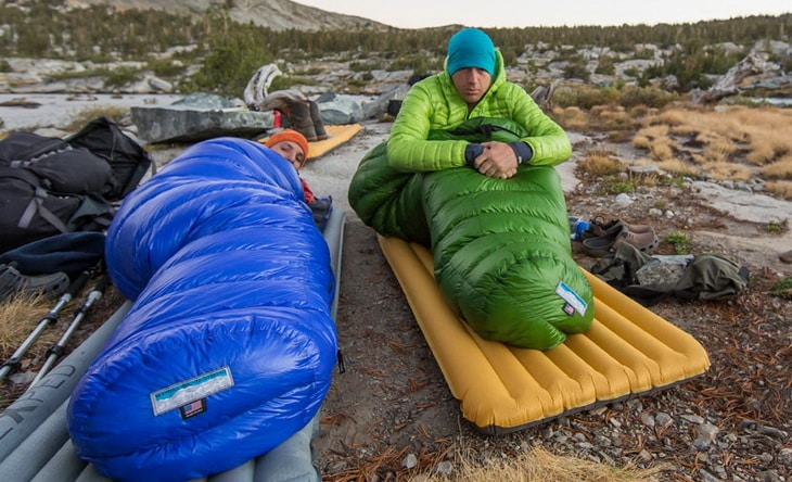 Two adults in Western Mountaineering Puma Gore WS Sleeping Bags in the wilderness