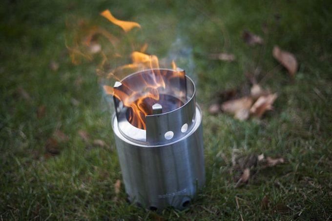 solo stove burning on grass