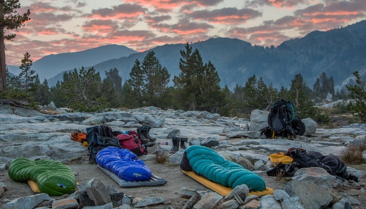 Western Mountaineering Puma Gore WS Sleeping Bags on the Ground and a gorgeous landscap in the background