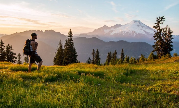 Backpacker watching the landscape in front of him