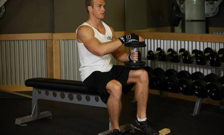 Man Performing Single Leg Dumbbell Press