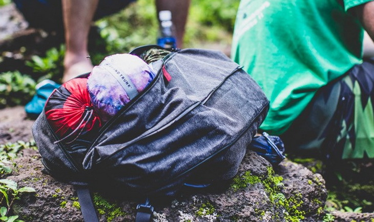 Grand Trunk Nano 7 Hammock in a backpack on the ground