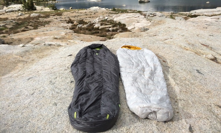 Globe Semi-Rectangular Sleeping Bags on the ground outside