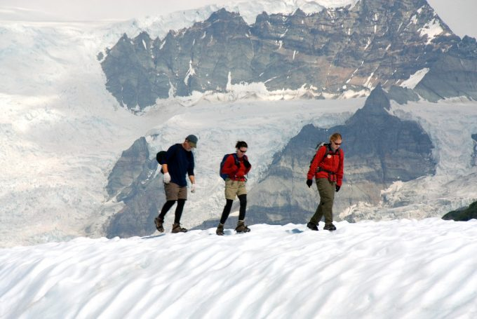 Hikers climbing in snowy mountains in Alaska