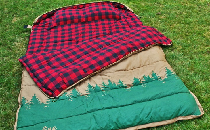 Rectangular sleeping bag on the grass