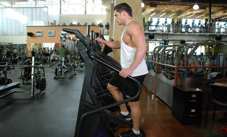 Man Getting Ready for The Stairmaster Exercise